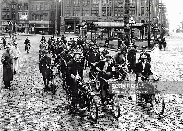 Photograph of a motorcycle gang sitting on their bikes in Seattle Dated 1914