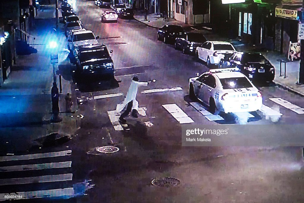 A photograph of a video survelliance image shows Edward Archer the suspect in a shooting ambush last night of 33yearold Police Officer Jesse Hartnett...