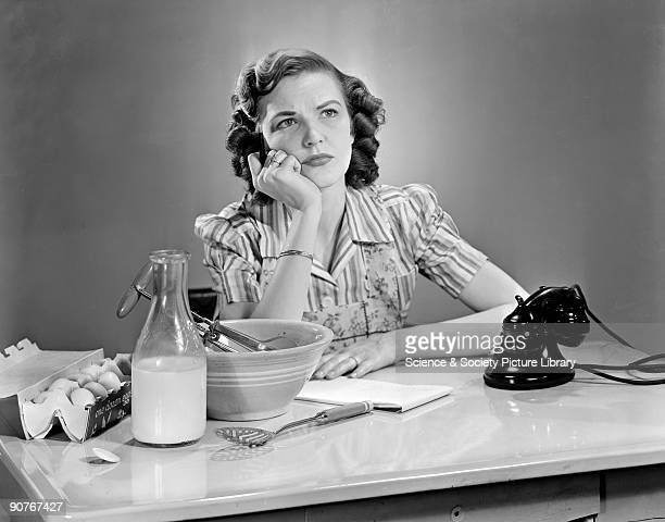 A photograph of a woman writing a list at a work surface taken by Photographic Advertising Limited in 1956 Photographic Advertising Limited founded...