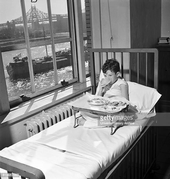 Photograph of a young boy recovering in hospital from burns The Nurses placed him near the window so that he can watch the boats pass Dated 1942