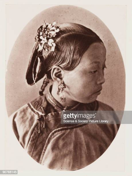 A photograph of a young Chinese woman by John Thomson published in 1873 in the book 'Foochow and the River Min' This sensitive portrait shows details...