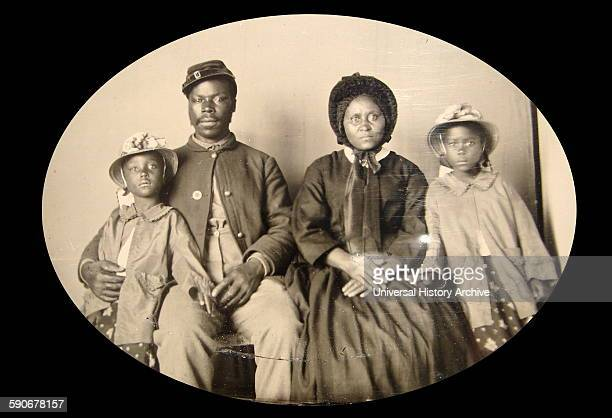 Photograph of an African American Civil War Union soldier with his family c186365