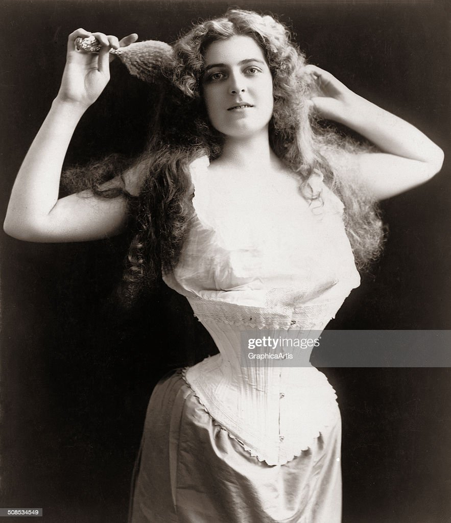 Photograph of an American woman wearing a corset toned silver print