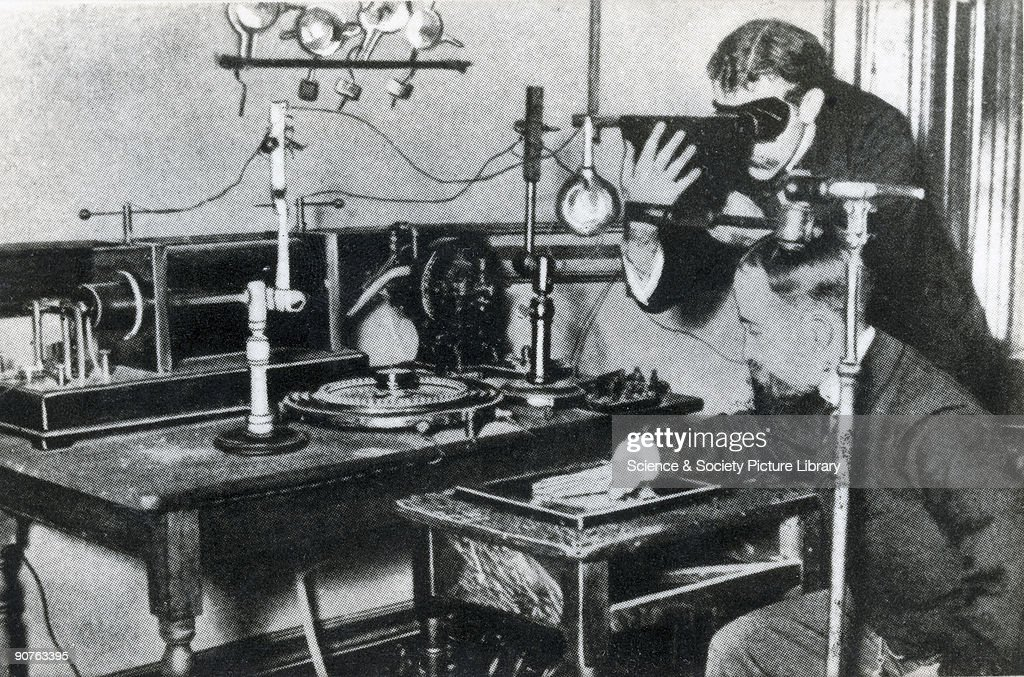 Photograph of an early method of testing the output of Xrays by observing the appearance of a hand through a fluoroscope