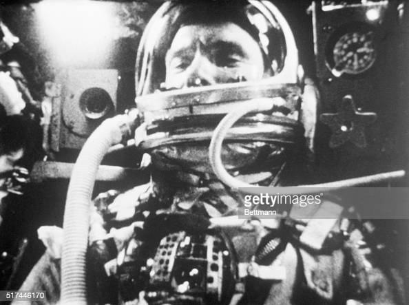 A photograph of astronaut John Glenn inside the Friendship 7 space capsule as it orbits the Earth during the Mercury 6 mission