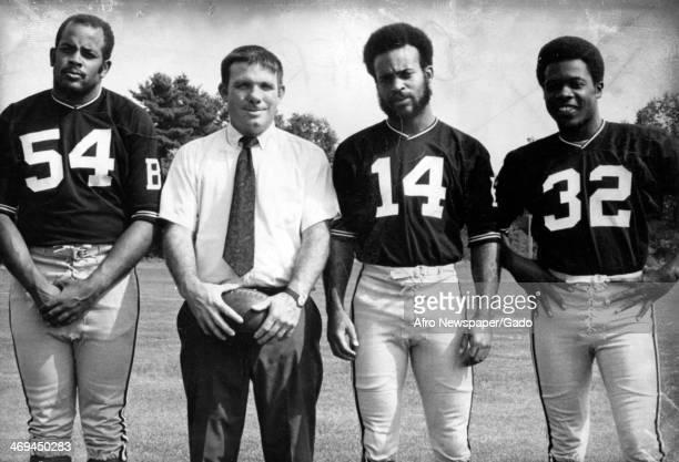 A photograph of football Coach Jim Lentz posing with team players 1980