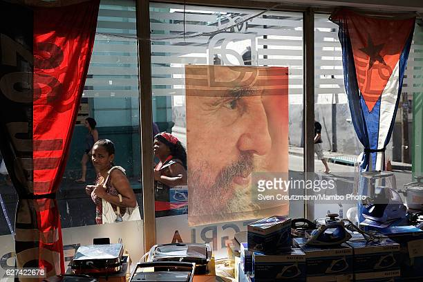 A photograph of former Cuban President Fidel Castro hangs in a shop window before his remains pass by on their fourday journey across the country...
