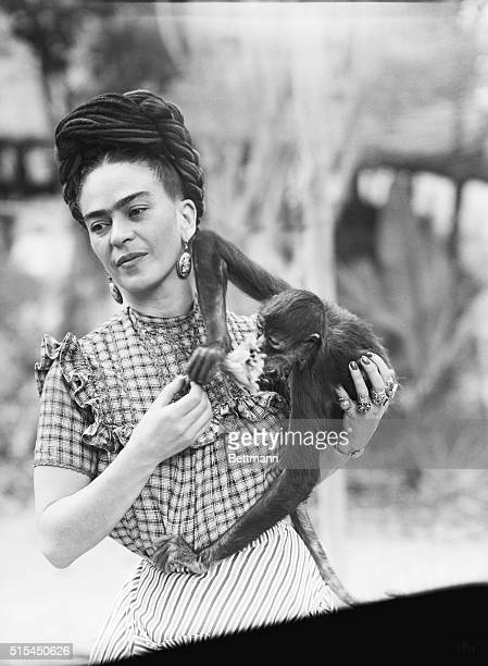 Photograph of Frida Kahlo Mexican painter holding a monkey She is the wife of Diego Rivera