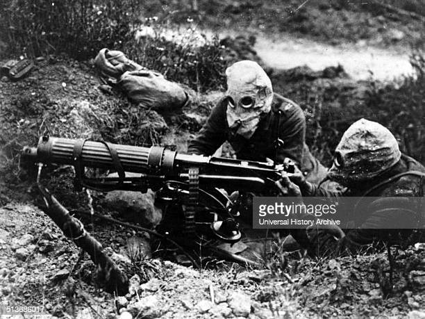 Photograph of gasmasked men of the British Machine Gun Corps with a Vickers machine gun during the first battle of the Somme Dated 1916