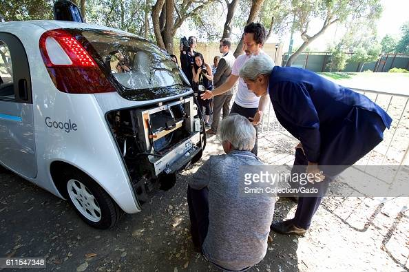 Photograph of Google cofounder Sergey Brin showing US Secretary of State John Kerry the computer inside a selfdriving car Palo Alto California June...