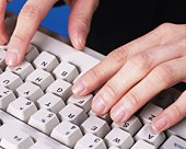 Photograph of hands typing computer keyboard, Close Up, Studio