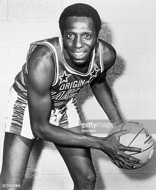Photograph of Lemon Meadowlark of the Harlem Globetrotters Photo shows Meadowlark with basketball in an action pose in front of a brick wall Undated...
