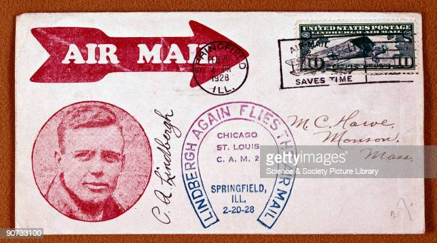 Photograph of Lindbergh with the slogan 'Lindbergh Again Flies the Airmail' Lindbergh was an airmail pilot and later made the first solo nonstop...