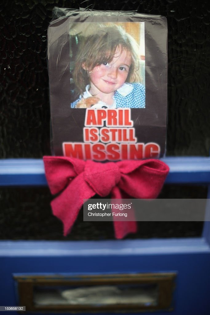 A photograph of missing five-year-old April Jones adorns a door as police continue their search to find the 5 year old girl on October 8, 2012 in Machynlleth, Wales. April Jones was abducted from outside her house last week in Machynlleth mid Wales. Local man Mark Bridger appeared before magistrates earlier today charged with her murder, abduction and perverting the course of justice.