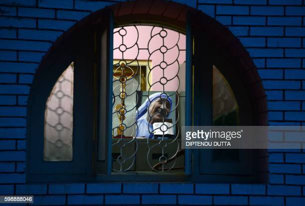 TOPSHOT A photograph of Mother Teresa is displayed at The Our Lady Queen Church in Siliguri on September 3 during a special prayer on the eve of her...