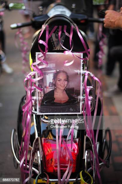 A photograph of Olivia Campbell who died in Monday's terror attack is attached to the back of a scooter as bikers arrive to pay their respects at St...