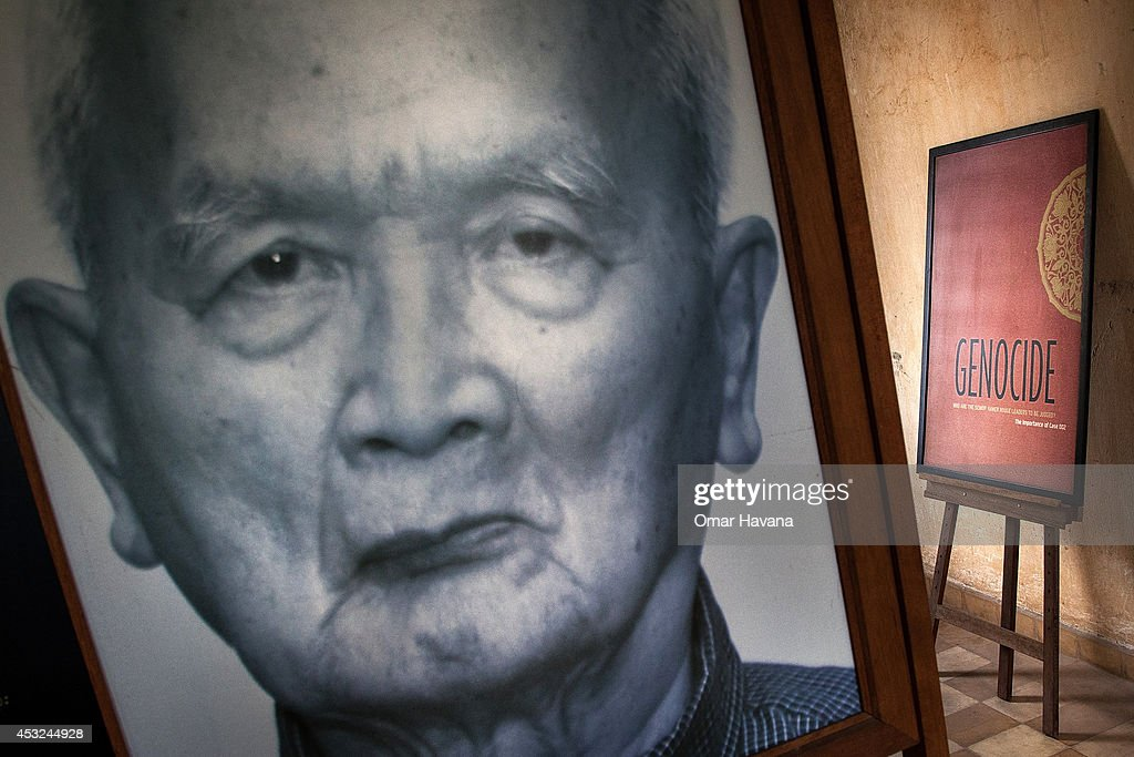 A photograph of one of the former Khmer Rouge leaders, <a gi-track='captionPersonalityLinkClicked' href=/galleries/search?phrase=Nuon+Chea&family=editorial&specificpeople=767256 ng-click='$event.stopPropagation()'>Nuon Chea</a>, stands in one of the rooms of Tuol Sleng prison, also known as S-21, on August 6, 2014 in Phnom Penh, Cambodia. S-21 is believed to have held approximately 14,000 prisoners while in operation, most of whom were intellectuals and high-ranking officials, including Khmer Rouge officials accused of treason and espionage. Only 12 survived. One day before Cambodia's UN-backed court delivers verdicts for two former Khmer Rouge leaders - <a gi-track='captionPersonalityLinkClicked' href=/galleries/search?phrase=Nuon+Chea&family=editorial&specificpeople=767256 ng-click='$event.stopPropagation()'>Nuon Chea</a>, also known as 'Brother Number Two', and Khieu Samphan, the former head of State - some Cambodians remember this tragic period in the country's history by visiting places related to the genocide in the capital Phnom Penh. In April 1975, the Communist Party of Kampuchea, also known as the Khmer Rouge, seized power in Cambodia, forcibly relocating the population to work in labor camps around the country and imprisoning an increasing number of people. Up until the regime's overthrow in January 1979, the policies that were put in place resulted in the creation of a state defined by repression and violence. Close to two million people lost their lives, due to forced labor, starvation, torture and executions.