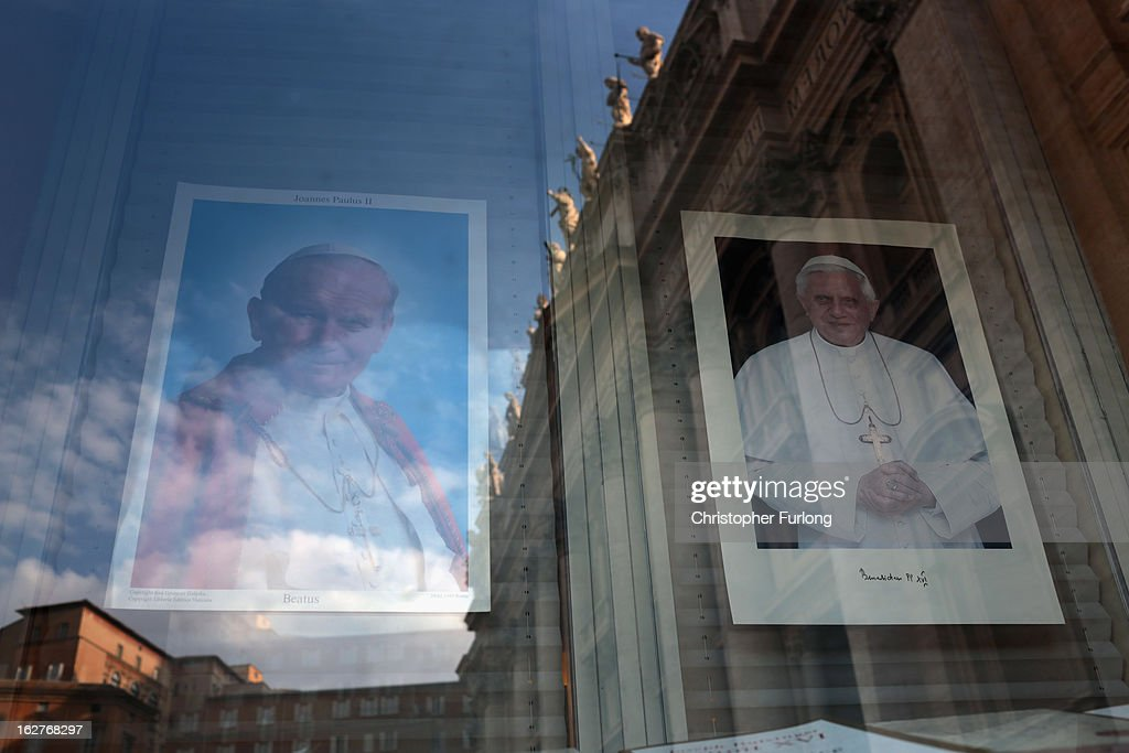 A photograph of Pope Jean-Paul II and Pope Benedict XVI (R) adorn a window display in the Vatican book shop next to St Peter's Basilica on February 26, 2013 in Rome, Italy. The Pontiff will hold his last weekly public audience on February 27, 2013 before he retires the following day. Pope Benedict XVI has been the leader of the Catholic Church for eight years and is the first Pope to retire since 1415. He cites ailing health as his reason for retirement and will spend the rest of his life in solitude away from public engagements.