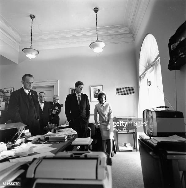 Photograph of President John F Kennedy and First Lady Jacqueline Kennedy watching flight of Astronaut Alan Shepard on television Dated 1961
