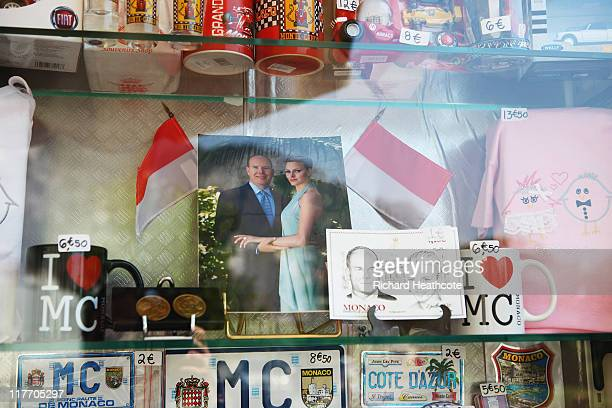 A photograph of Prince Albert II of Monaco and Charlene Wittstock is displayed in a gift shop ahead of their Royal Wedding on June 30 2011 in Monaco...