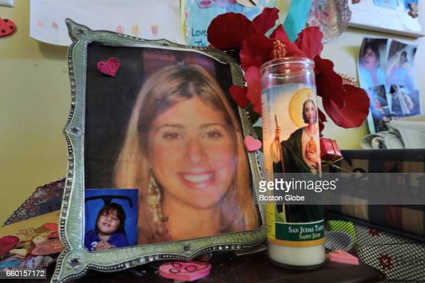 A photograph of Richard Nunez's wife Rosanna adorns an end table in the living room of Nunez's apartment with a lit candle and a small photo of their...