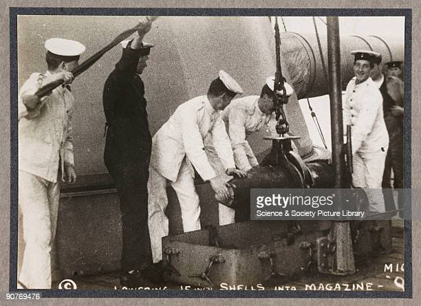 A photograph of sailors loading shells into HMS Elizabeth's magazine taken by an unknown photographer in about 1916 This photograph is from an album...