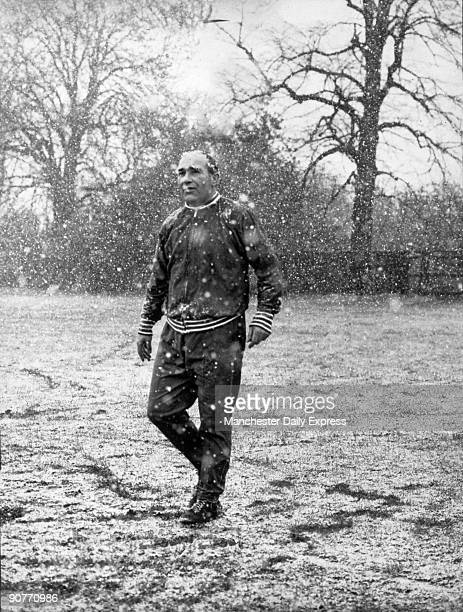Photograph of Sir Alf Ramsey England football manager on the training ground in the snow 2 April 1968 Ramsey played football for Southampton and...