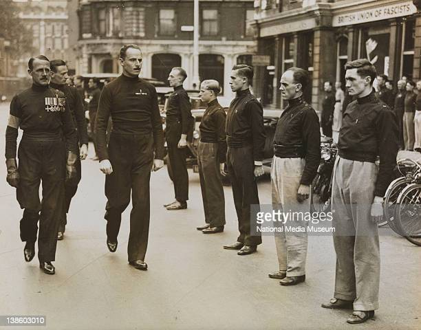 A photograph of Sir Oswald Mosley the founder of the British Union of Fascists inspecting members of their Transport Section outside their...