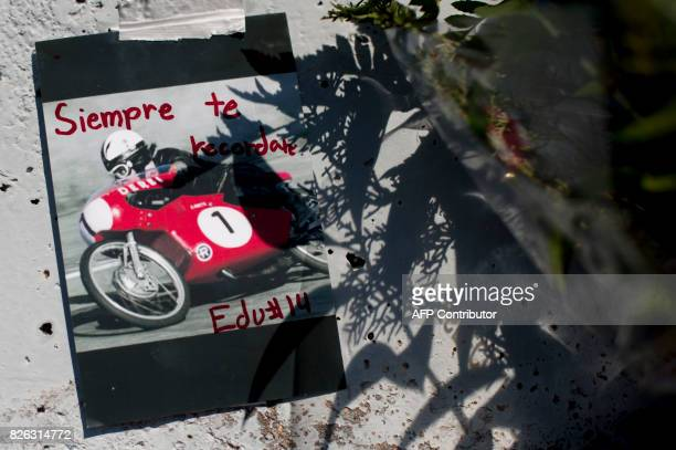 A photograph of Spanish former motorcyclist Angel Nieto with the legend 'I will rememeber you forever' is stuck on a tribute monument during an...
