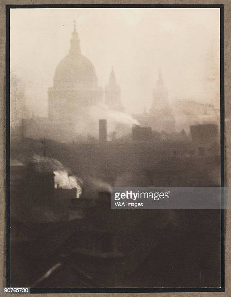 Photograph of St Paul�s Cathedral London surrounded by smoking chimneys by Walter Benington