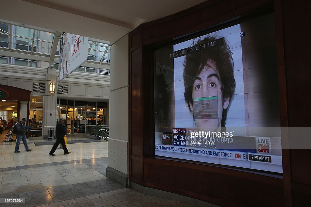 A photograph of suspect Dzhkokhar Tsarnaev is played on a television in a shopping center near the site of the Boston Marathon bombings on April 23, 2013 in Boston, Massachusetts. Business owners and residents of the closed section were allowed to return to their properties today while under escort of city staff.