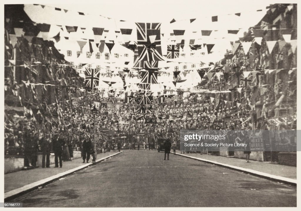 A photograph of the decorations in Catherine Road, Tottenham, London, taken by an unknown photographer in May 1937. The street had been decorated to celebrate the Coronation of King George VI. This photograph is from an album compiled by Kodak Limited to record the coronation of King George VI (1895-1952) and Queen Elizabeth (1900-2002) on 12 May 1937. George VI was the second son of George V and Mary of Teck. In 1923 he married Lady Elizabeth Bowes-Lyon, who bore him two daughters, Elizabeth (Queen Elizabeth II) and Margaret. He died from cancer on 6 February, 1952.