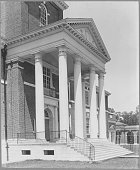 A photograph of the exterior of Gilman Hall on the Homewood campus of Johns Hopkins Univeristy in Baltimore Maryland showing landscaping and...