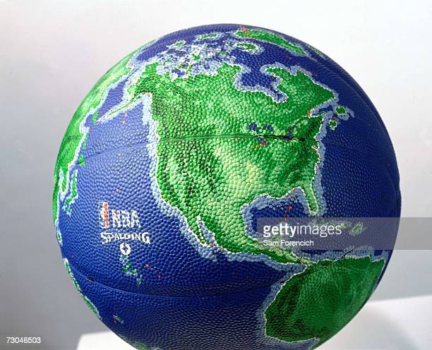 Photograph of the Spalding specially issued NBA basketball resembling the globe NOTE TO USER User expressly acknowledges that by downloading and or...