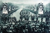 Photograph of the Triumphant march of the Guards through London The photograph shows some of the 8000 who took part passing the laurelled pillars in...