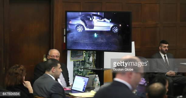 A photograph of the victims' car with their sheetcovered bodies is show during the double murder trial of former New England Patriots tight end Aaron...