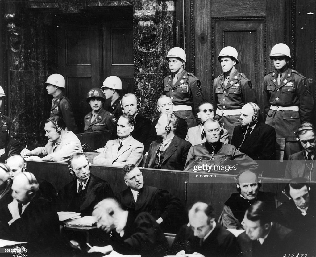 A Photograph of Top Nazi Leaders on Trial in the Palace of Justice in Nuremberg, Germany. Left to Right Front Row <a gi-track='captionPersonalityLinkClicked' href=/galleries/search?phrase=Hermann+Goering&family=editorial&specificpeople=93518 ng-click='$event.stopPropagation()'>Hermann Goering</a>, <a gi-track='captionPersonalityLinkClicked' href=/galleries/search?phrase=Rudolf+Hess&family=editorial&specificpeople=94030 ng-click='$event.stopPropagation()'>Rudolf Hess</a>, <a gi-track='captionPersonalityLinkClicked' href=/galleries/search?phrase=Joachim+Von+Ribbentrop&family=editorial&specificpeople=93593 ng-click='$event.stopPropagation()'>Joachim Von Ribbentrop</a>, Gen. <a gi-track='captionPersonalityLinkClicked' href=/galleries/search?phrase=Wilhelm+Keitel&family=editorial&specificpeople=94240 ng-click='$event.stopPropagation()'>Wilhelm Keitel</a>, Back Row Admirals Karl Doenitz and Erich Raeder, Baldur Von Schirach and Fritz Sauckel, November 29th, 1945.