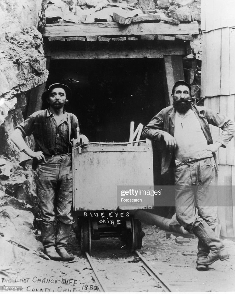 A Photograph of Two Gold Miners Standing Outside of the Last Chance Mine Wearing Levi Jeans in Placer County California circa 1882