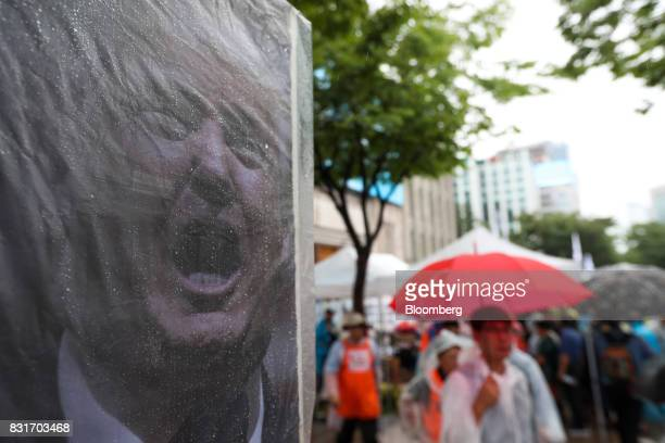 A photograph of US President Donald Trump sits on a protest banner during a rally against the deployment of the Terminal HighAltitude Area Defense...