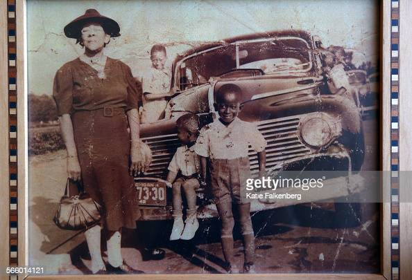 A photograph of Vernon Watkins' grandmother Beatirce Spivey with her grandsons including Vernon Watkins far right looking into the car's window 4...