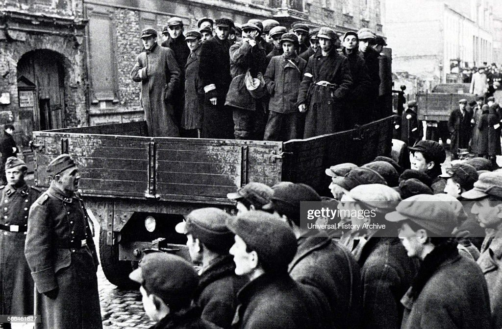 Photograph of Young Jewish men being carted off in the Warsaw Ghetto Dated 1941