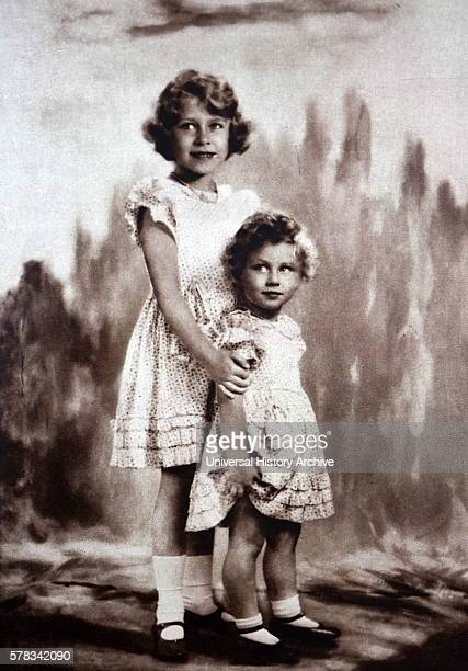 Photograph of young Princess Elizabeth and Princess Margaret posing for a picture Dated 20th Century