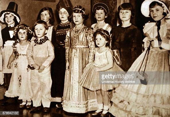 Photograph of young Princess Elizabeth Princess Margaret attending a party with other children Dated 20th Century