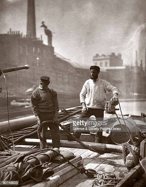 Photograph produced using the Woodburytype process of two workers on the deck of a barge on the River Thames taken from 'Street Life in London'...