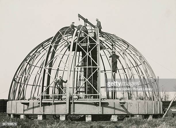 Photograph showing a partly assembled dome being built by the company of Sir Howard Grubb Parsons and Co in NewcastleuponTyne England The dome was to...