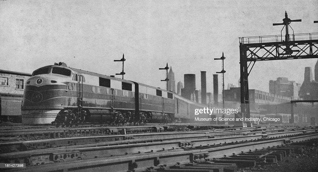 A photograph showing an image of the Royal Blue train on the Baltimore and Ohio Railroad leaving Jersey City terminal Jersey City New Jersey 1946...