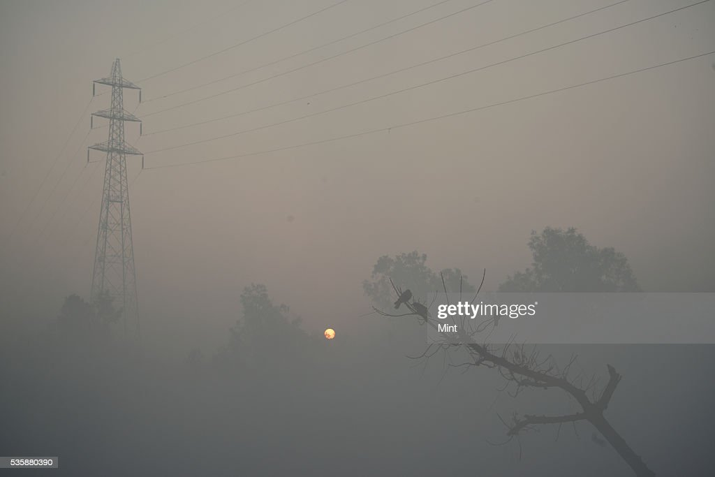 Photograph showing early morning fog in winter at bank of Yamuna on December 9, 2015 in New Delhi, India.