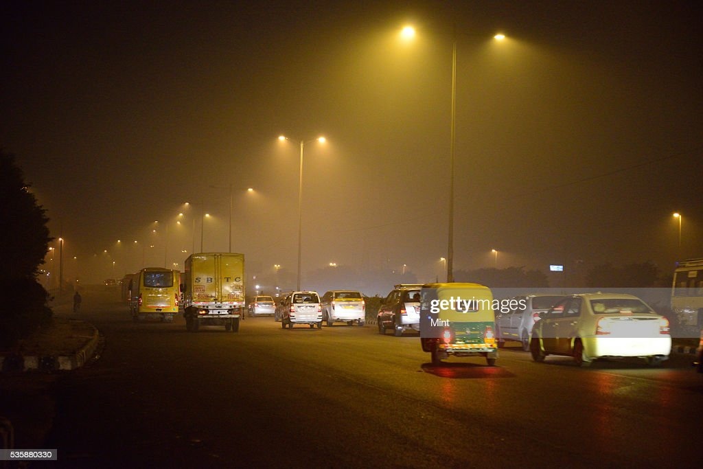 Photograph showing early morning fog in winter at NH 24 on December 9, 2015 in New Delhi, India.