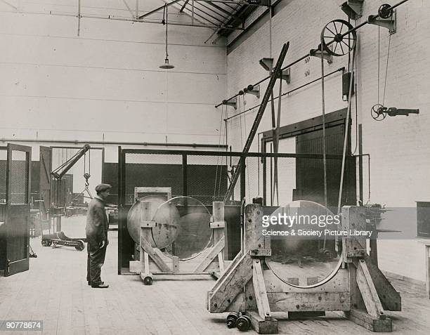 Photograph showing the interior of the optical workshop of Sir Howard Grubb Parsons and Company in Newcastle upon Tyne In this view a pair of glass...