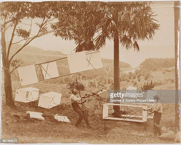Photograph showing two men with box kites of the type designed by Lawrence Hargrave the Englishborn Australian aeronautical pioneer Hargrave...